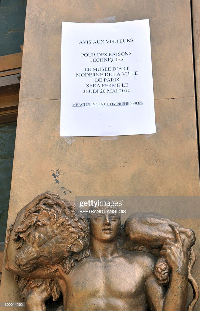 A picture taken on May 20, 2010 shows an information note on the door of the Paris' Musee d'Art Moderne (Paris modern art museum), closed after five works including paintings by modern masters Henri Matisse and Pablo Picasso have been stolen. The canvases, worth a total of 500 million euros (635 million dollars), were discovered missing from the city-run Musee d'Art Moderne when it opened its doors.