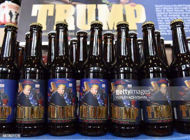 A picture taken on May 20 2017 at the Pravda breweryshop in the western Ukrainian city of Lviv shows bottles of just brewered lager beer called Trump...