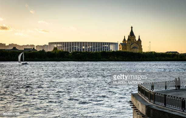 A picture taken on May 20 2018 shows the Nizhny Novgorod Arena and Alexander Nevsky Cathedral in Nizhny Novgorod Nizhny Novgorod stadium will host...