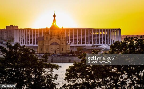 A picture taken on May 20 2018 shows the Nizhny Novgorod Arena and Alexander Nevsky Cathedral at sunset in Nizhny Novgorod Nizhny Novgorod stadium...