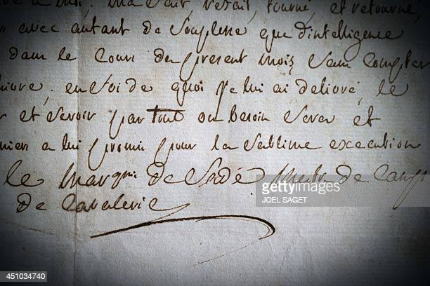 A picture taken on May 21 2014 in BoulogneBillancourt outside Paris shows a very rare signature of French writer the Marquis de Sade with his...