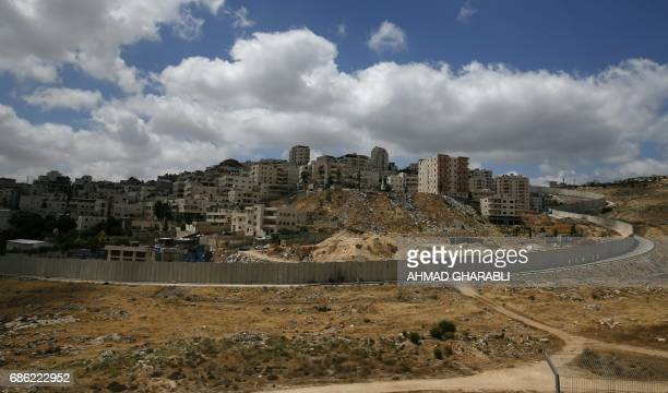 Picture taken on May 21, 2017 from the Jewish settlement of Pisgat Zeev shows the Palestinian Shuafat refugee camp in east jerusalem behind the...
