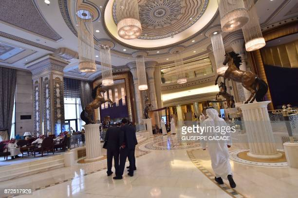 A picture taken on May 21 shows the hallway of the RitzCarlton Hotel in the Saudi capital Riyadh Its chandelierstudded ballrooms hosted global...