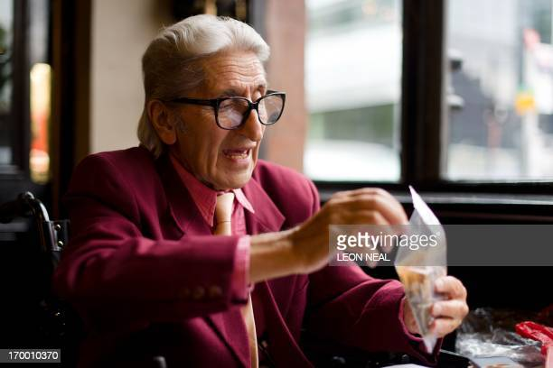 A picture taken on May 22 2013 shows photographer Ray Bellisario during an interview with AFP in London The world's press will train their lenses on...