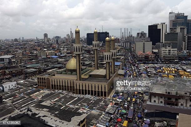 A picture taken on May 22 2015 shows Nigeria's commercial capital of Lagos ahead the inauguration of Presidentelect Muhammadu Buhari on May 29 Buhari...