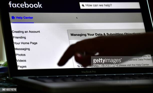Picture taken on May 22 2018 shows a woman managing her facebook account in Berlin Facebook chief Mark Zuckerberg apologised to the European...