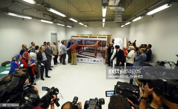 A picture taken on May 23 2017 shows the gilded bed of the ancient Egyptian boyking Tutankhamun after its arrival from the Egyptian Museum in the...