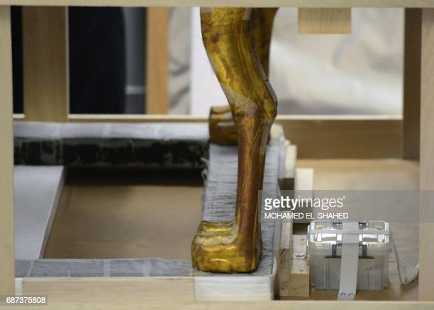 A picture taken on May 23 2017 shows the legs of the gilded bed of the ancient Egyptian boyking Tutankhamun featuring posts made of carved lion heads...