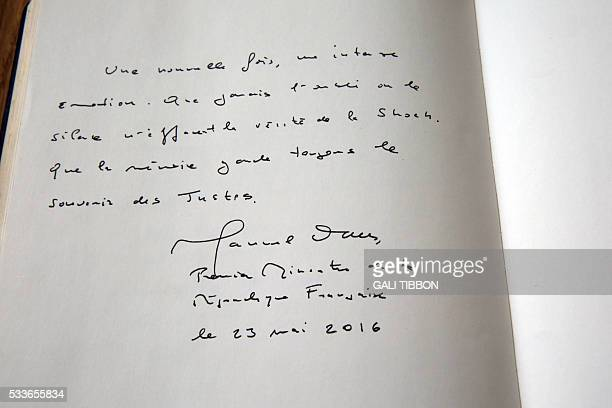 A picture taken on May 23 shows the Yad Vashem Holocaust Memorial Muesum's guest book signed by the French prime minister during his visit to the...