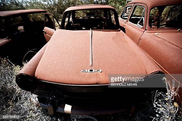 A picture taken on May 25 2016 shows an abandoned late 1960s Peugeot 404 car parked at the Sovereign Base Area of Akrotiri a British overseas...