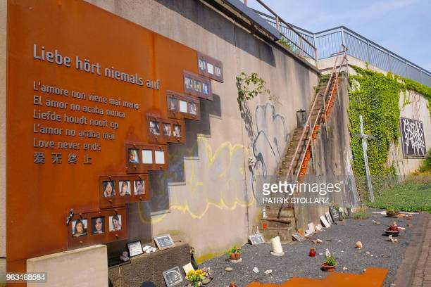 A picture taken on May 28 2018 in Duisburg western Germany shows a view of the socalled Love Parade memorial paying tribute to the victims of a crowd...