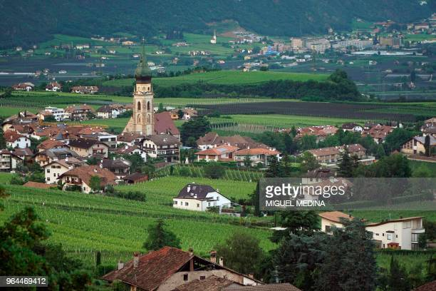 Picture taken on May 28, 2018 shows a general view of Appiano, near the city of Bolzano, and on the left side the village of San Paolo and its church...
