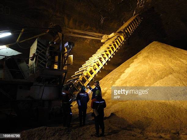 A picture taken on May 28 shows employees working at the Uralkali Russian potash fertilizer company in the Urals city of Berezniki more than 1200...