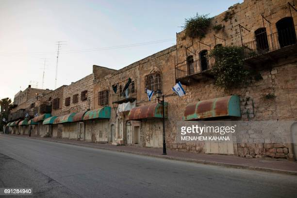 A picture taken on May 29 2017 show the Shuhada Street which used to be a large Palestinian market in the divided West Bank city of Hebron After half...