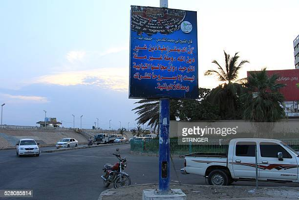 A picture taken on May 3 2016 shows a general view of a banner hung by AlQaeda militants announcing Islamists' orders of streets with a slogan...