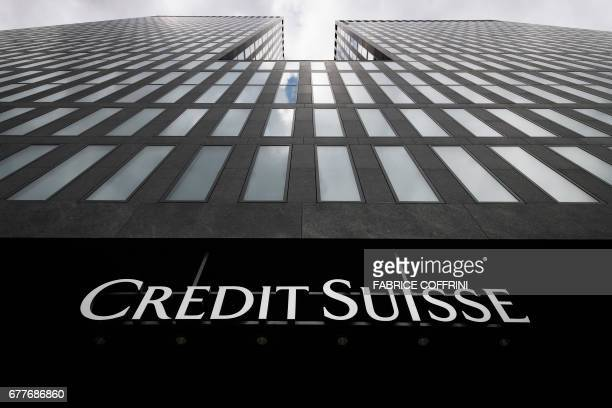 A picture taken on May 3 2017 in Zurich shows the logo of branch of Swiss banking group Credit Suisse / AFP PHOTO / Fabrice COFFRINI