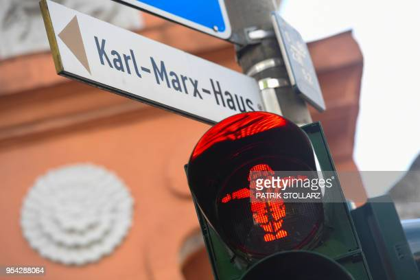 A picture taken on May 3 2018 shows a pedestrian traffic light with German philosopher Karl Marx as the figure in Trier southwestern Germany Germany...