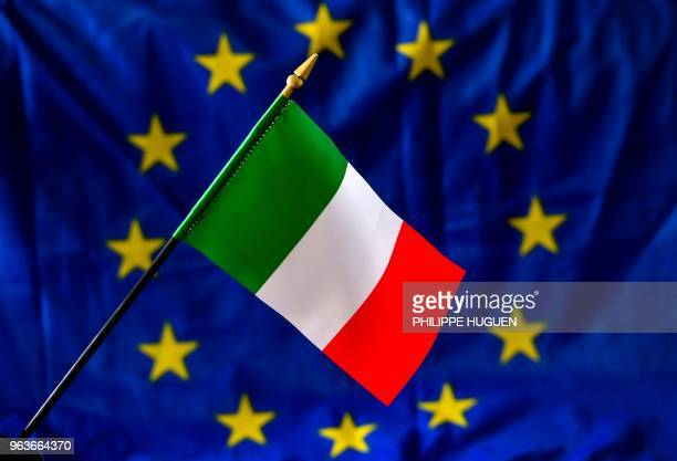 A picture taken on May 30 2018 shows an Italian flag in front of the European Union flag Italy one of the European Union's biggest economies has been...