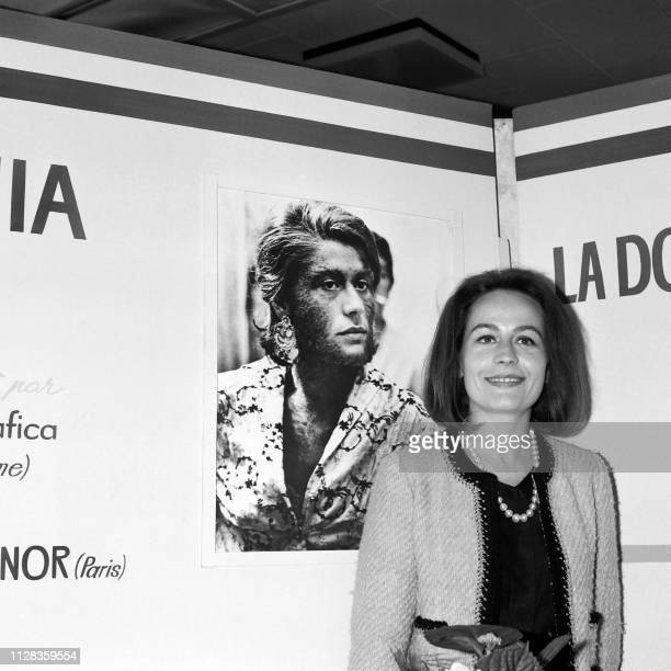 Picture taken on May 4 1964 at Cannes showing French actress Annie Girardot in front of the poster schowing her as 'Le mari de la femmme à barbe' of...