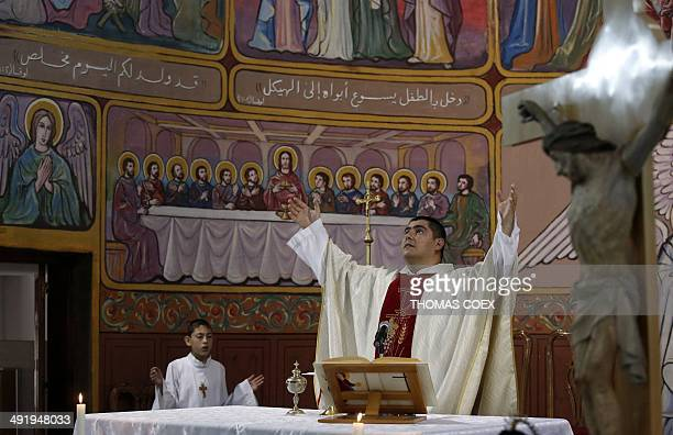 A picture taken on May 4 2014 shows Argentinian Catholic priest Father Jorge Hernandez leading the Sunday mass at the Holy Family Church in Gaza City...