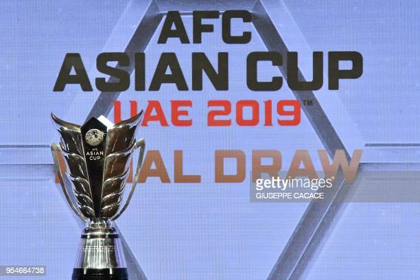 A picture taken on May 4 2018 shows the official championship trophy of the AFC Asian cup on display during final draw for the 2019 edition of the...