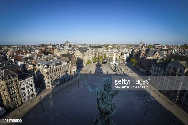 Picture taken on May 4, 2020 from the Royal Palace shows a general view of Dam Square prior to a wreath-laying ceremony attended by the King and...