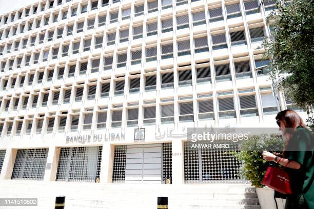 A picture taken on May 4 shows employees of the Central Bank in the capital Beirut leaving their offices