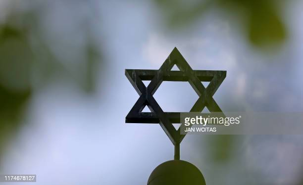 Picture taken on May 5 2013 shows a Star of David on the synagogue of the Jewish community in Halle an der Saale eastern Germany At least two people...