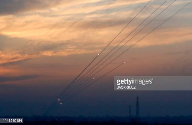 Picture taken on May 5, 2019 from the Israel-Gaza border shows a barrage of rockets being fired from the Hamas-run Palestinian enclave. - Gaza...