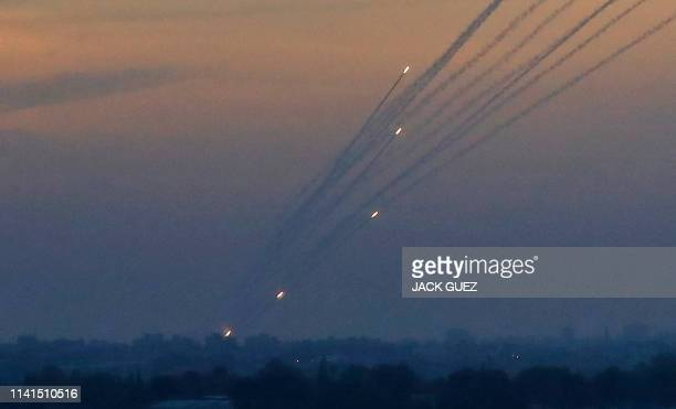 TOPSHOT A picture taken on May 5 2019 from the IsraelGaza border shows a barrage of rockets being fired from the Hamasrun Palestinian enclave Gaza...