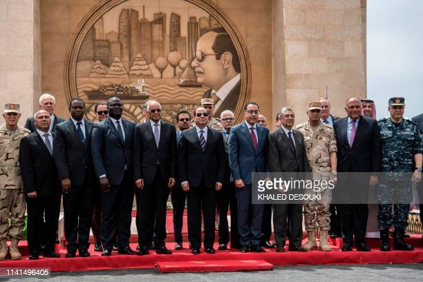 Picture taken on May 5 shows Egyptian President Abdel Fattah al-Sisi posing with ministers and some diplomats during the inauguration of a tunnel...