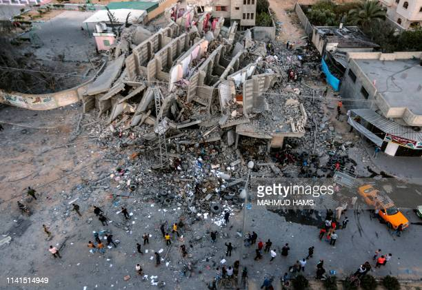 TOPSHOT A picture taken on May 5 shows the remains of a building in Gaza City after it was hit during Israeli air strikes Israel's military carried...