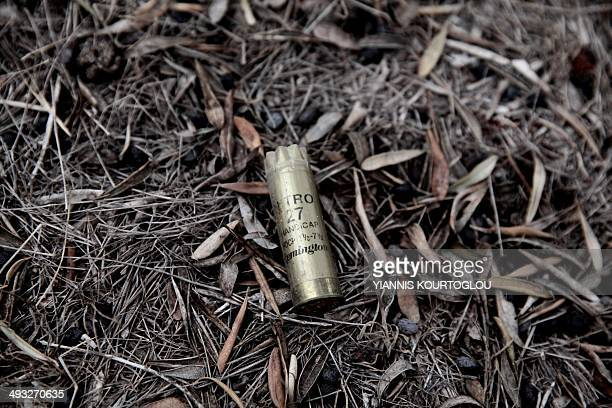 A picture taken on May 6 2014 shows a cartridge case in a field of a British sovereign base in the region of Dhekelia between the southern Cypriot...