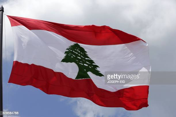 A picture taken on May 6 2016 shows a giant Lebanese flag fluttering in Martyrs square in central Beirut at the occasion of the 100 years since the...