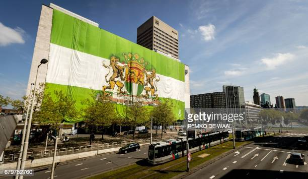 A picture taken on May 6 2017 shows a flag placed by Feyenoord fans on a building in the city center of Rotterdam on the eve of the Dutch Eredivisie...