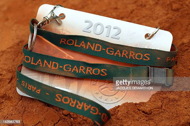A picture taken on May 7 2012 shows a 2012 official badge of the French Open tennis tournament on a clay court at the Roland Garros stadium in Paris...