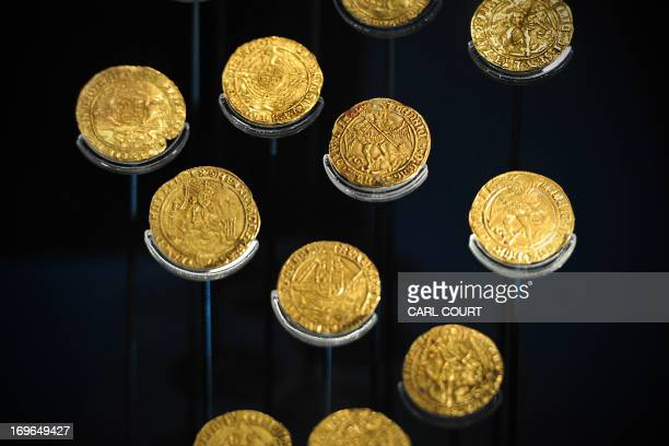 Picture taken on May 7, 2013 shows gold coins found with the wreck of the Tudor warship Mary Rose on display during a press preview of the new Mary...