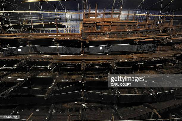 Picture taken on May 7, 2013 shows part of the hull of the Tudor warship Mary Rose on display during a press preview of the new Mary Rose Museum in...