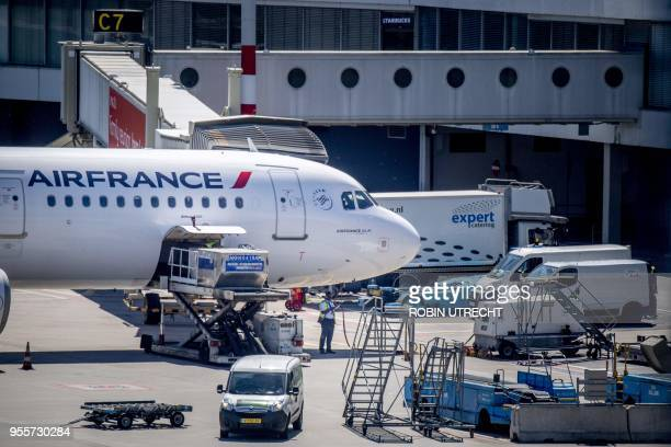 A picture taken on May 7 2018 at Schiphol Airport shows an aircraft of Air France The Air FranceKLM price on the Amsterdam stock exchange plummeted...