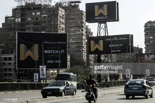 A picture taken on May 7 2019 shows billboards advertising Watch iT Egypt's first videostreaming app in the capital Cairo The videostreaming app was...