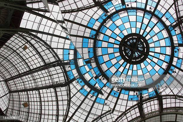 A picture taken on May 8 2012 shows the reflection in a miror of the Grand Palais in Paris prior to the launching of the Monumenta 2012 event with...