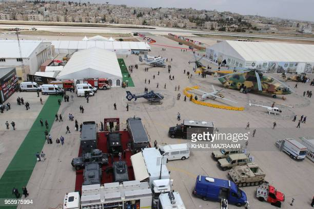 A picture taken on May 8 2018 shows military aircraft and vehicles on display during the opening day of the Special Operations Forces Exhibition and...