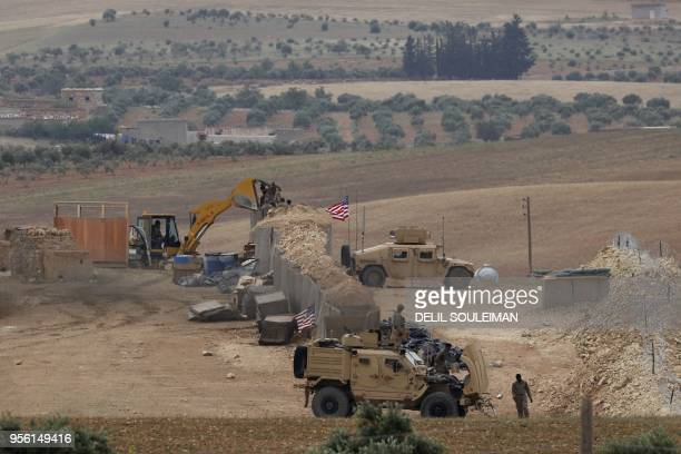 A picture taken on May 8 2018 shows vehicles and structures of the USbacked coalition forces in the northern Syrian town of Manbij The Syrian...
