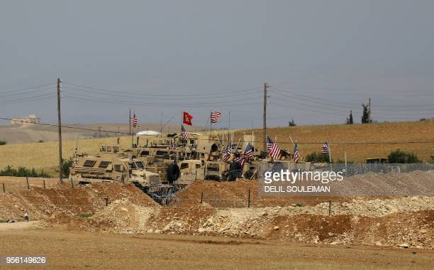 A picture taken on May 8 2018 shows vehicles of the USbacked coalition forces in the northern Syrian town of Manbij The Syrian Observatory for Human...