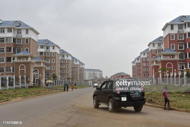 A picture taken on May 8 2019 shows housing estates in the Malabo II neighbourhood of Malabo In a country awash with oil the poorest survive in...