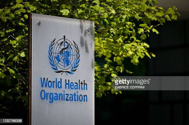 Picture taken on May 8, 2021 shows a sign of the World Health Organization at the entrance of their headquarters in Geneva amid the Covid-19...
