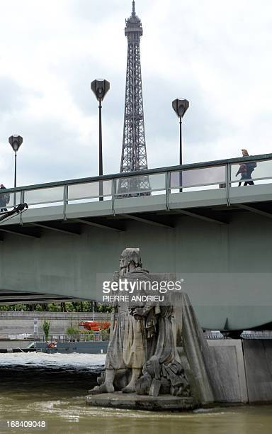 Picture taken on May 9 2013 shows the statue of a Zouave soldier in front of the Eiffel tower in Paris Access to the footpaths by the river...