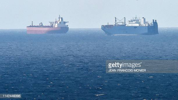 Picture taken on May 9, 2019 from northern port of Le Havre, shows Saudi cargo ship Bahri Yanbu next to British crude oil tanker Nordic Space waiting...