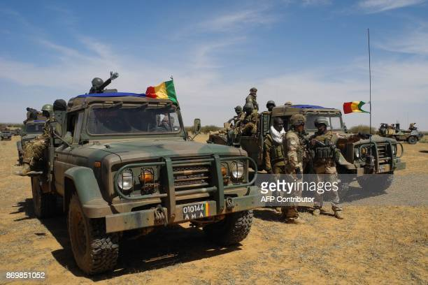 A picture taken on November 1 2017 shows vehicules of the Malian army taking part in the 'Hawbi' tactical coordination operation in central Mali in...