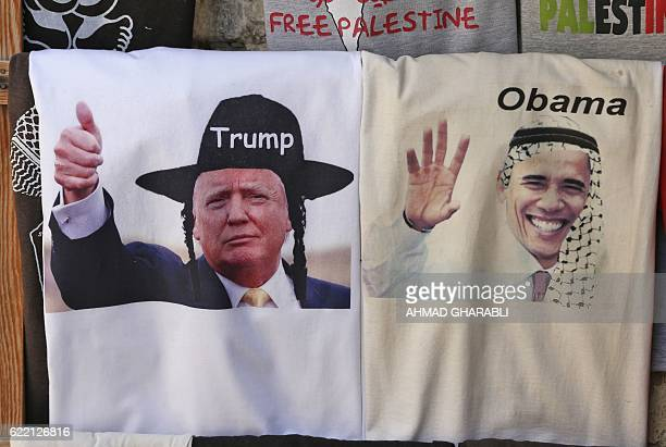TOPSHOT A picture taken on November 10 2016 shows Tshirts bearing montaged images of US President Barack Obama wearing a kaffiyeh and presidentelect...